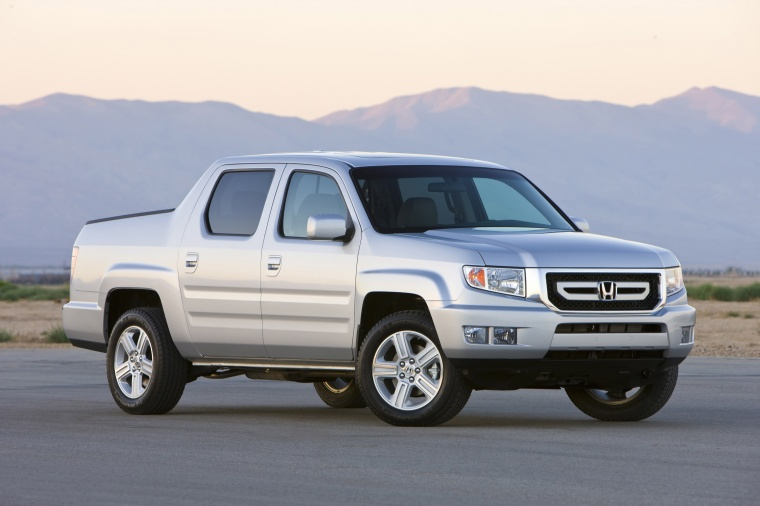 2010 Honda Ridgeline in Alabaster Silver Metallic from a front right three-quarter view