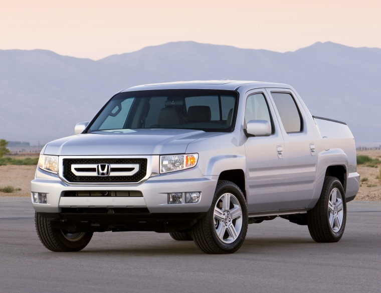 2010 Honda Ridgeline in Alabaster Silver Metallic from a front left view