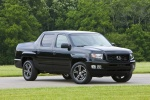 2012 Honda Ridgeline in Crystal Black Pearl - Static Front Right Three-quarter View
