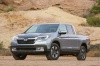 2017 Honda Ridgeline AWD in Lunar Silver Metallic from a front left view