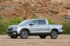 2017 Honda Ridgeline AWD in Lunar Silver Metallic from a front left three-quarter view