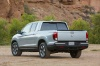 2017 Honda Ridgeline AWD in Lunar Silver Metallic from a rear left view