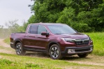 2017 Honda Ridgeline AWD in Deep Scarlet Pearl - Driving Front Right Three-quarter View