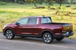 2017 Honda Ridgeline AWD in Deep Scarlet Pearl - Driving Rear Left Three-quarter View