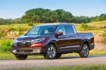 2018 Honda Ridgeline AWD in Deep Scarlet Pearl - Driving Front Left Three-quarter View