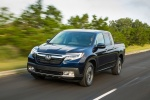 2018 Honda Ridgeline AWD in Obsidian Blue Pearl - Driving Front Left View