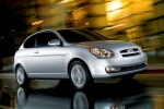 2010 Hyundai Accent Hatchback in Platinum Silver Pearl - Driving Front Right Three-quarter View