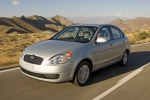 2011 Hyundai Accent Hatchback in Platinum Silver Pearl - Driving Front Left Three-quarter View