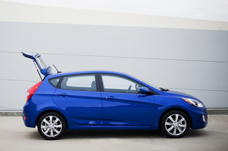 2013 Hyundai Accent Hatchback in Marathon Blue from a side view