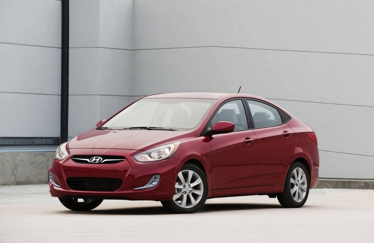 2013 Hyundai Accent GLS Sedan in Boston Red from a front left three-quarter view