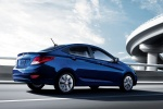 2013 Hyundai Accent GLS Sedan in Marathon Blue - Driving Rear Right Three-quarter View