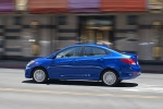 2013 Hyundai Accent GLS Sedan in Marathon Blue - Driving Rear Left Three-quarter View