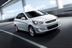 2013 Hyundai Accent GLS Sedan in Ironman Silver - Driving Front Right Three-quarter View