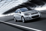 2013 Hyundai Accent GLS Sedan in Ironman Silver - Driving Front Right View