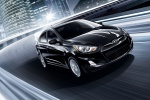 2013 Hyundai Accent Hatchback in Ultra Black - Driving Front Right View