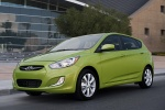 2013 Hyundai Accent Hatchback in Electrolyte Green - Static Front Left Three-quarter View