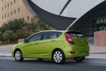 2013 Hyundai Accent Hatchback in Electrolyte Green - Static Rear Left Three-quarter View
