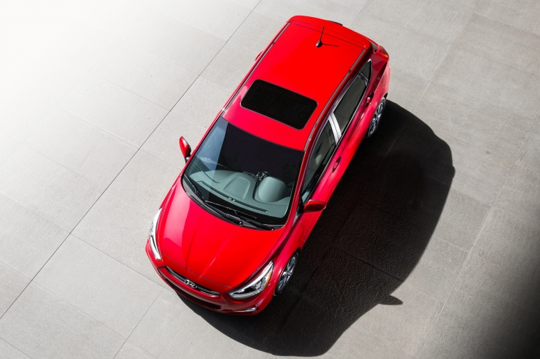 2015 Hyundai Accent Hatchback in Boston Red Metallic from a front left top view