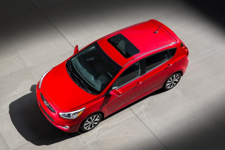2017 Hyundai Accent Hatchback in Boston Red Metallic from a front left three-quarter top view