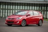 2017 Hyundai Accent Hatchback in Boston Red Metallic from a front left three-quarter view