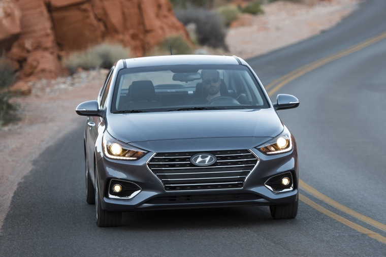 Driving 2018 Hyundai Accent Sedan in Urban Gray from a frontal view
