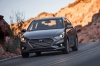 Driving 2018 Hyundai Accent Sedan in Urban Gray from a front left view