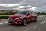 2018 Hyundai Accent Sedan in Pomegranate Red - Driving Front Left View