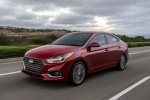 2018 Hyundai Accent Sedan in Pomegranate Red - Driving Front Left Three-quarter View