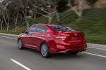 2018 Hyundai Accent Sedan in Pomegranate Red - Driving Rear Left View