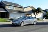 Driving 2017 Hyundai Azera Limited in Pewter Gray Metallic from a front left three-quarter view