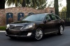 2015 Hyundai Equus Sedan in Night Shadow Brown from a front left three-quarter view