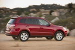 2010 Hyundai Santa Fe Limited AWD in Venetian Red - Driving Rear Right Three-quarter View