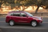Driving 2011 Hyundai Santa Fe Limited AWD in Venetian Red from a front right three-quarter view