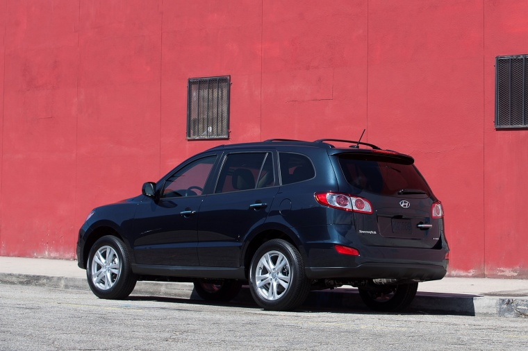 2012 Hyundai Santa Fe Limited AWD in Pacific Blue Pearl from a rear left three-quarter view