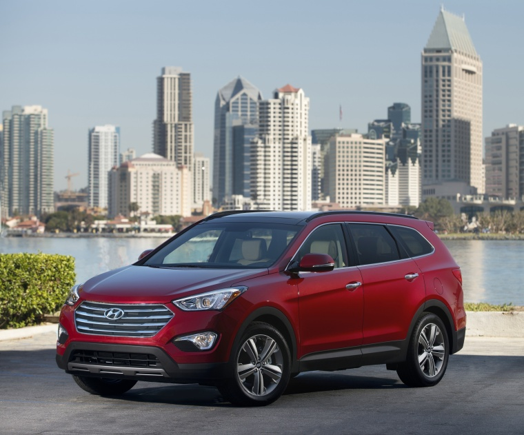 2013 Hyundai Santa Fe in Regal Red Pearl from a front left three-quarter view