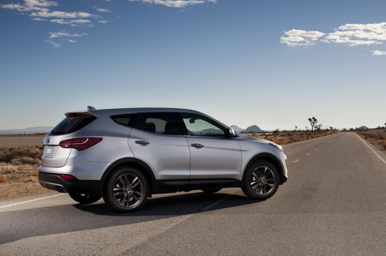 2014 Hyundai Santa Fe Sport in Moonstone Silver from a rear right three-quarter view