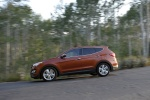 2014 Hyundai Santa Fe Sport in Serrano Red - Driving Left Side View