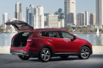 Picture of a 2016 Hyundai Santa Fe in Regal Red Pearl from a rear right three-quarter perspective