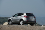 Picture of a 2016 Hyundai Santa Fe Sport in Sparkling Silver from a rear left three-quarter perspective