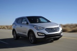 Picture of a driving 2016 Hyundai Santa Fe Sport in Sparkling Silver from a front right three-quarter perspective