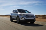 Picture of a driving 2016 Hyundai Santa Fe Sport in Sparkling Silver from a front right perspective