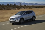Picture of a driving 2016 Hyundai Santa Fe Sport in Sparkling Silver from a front left three-quarter perspective