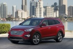 2016 Hyundai Santa Fe in Regal Red Pearl - Static Front Left Three-quarter View