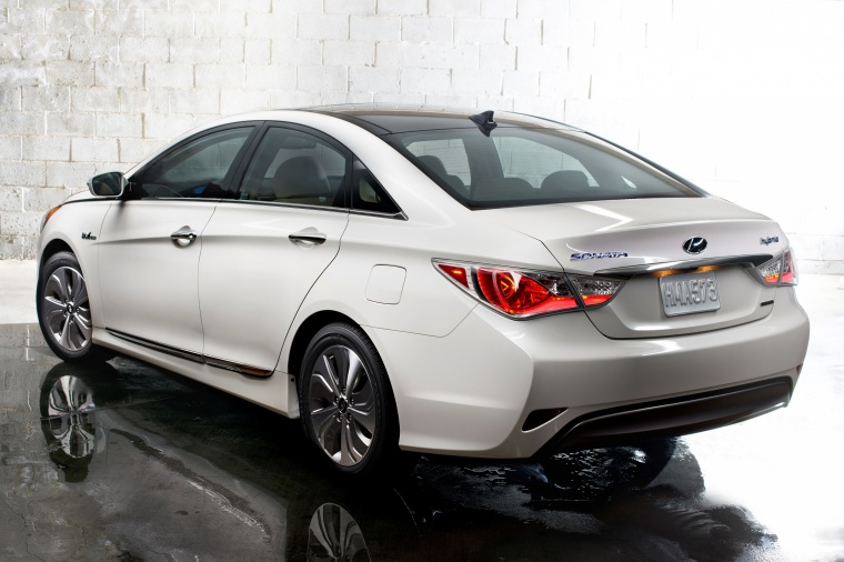 2015 Hyundai Sonata Hybrid Limited in Diamond White Pearl from a rear left three-quarter view