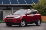 2010 Hyundai Tucson AWD in Garnet Red - Static Front Left View