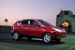 2012 Hyundai Tucson AWD in Garnet Red - Static Front Right Three-quarter View