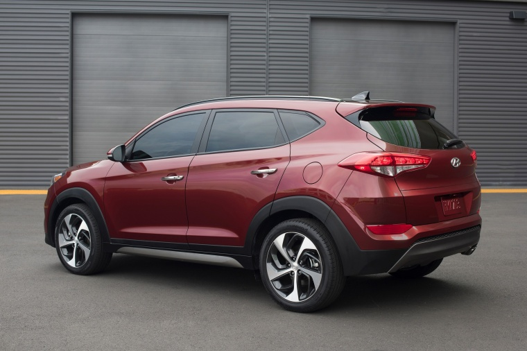 Picture of a 2016 Hyundai Tucson in Ruby Wine from a rear left three-quarter perspective