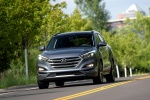 Picture of a driving 2016 Hyundai Tucson Limited 1.6T in Coliseum Gray from a front left perspective