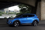 Picture of a 2016 Hyundai Tucson Limited 1.6T AWD in Caribbean Blue from a front left three-quarter perspective