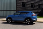 Picture of a 2016 Hyundai Tucson Limited 1.6T AWD in Caribbean Blue from a rear left three-quarter perspective